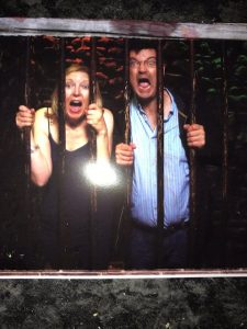 Showing two people in a prison cell